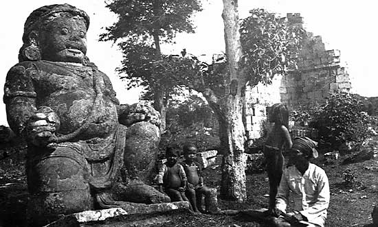 A ninth-century guardian statue near Hindu temple ruins in the vicinity of Prambanan, Jawa Tengah, ca. 1895