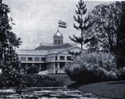 The Governor's Palace at Buitenzorg (now Bogor), flying a Dutch flag    <div title=