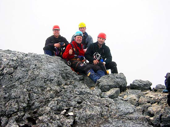 On the top of Carstensz Pyramid. From left Ivar, Torbjorn, Arnt Joar and Petter on the top of Carstensz Pyramid.