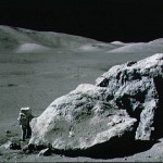 Harrison Schmitt by a lunar boulder