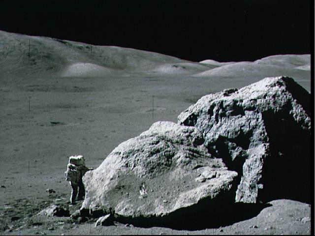Harrison Schmitt by a lunar boulder