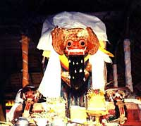 Holy Barong and Rangda masks over the offerings in Balingkang temple, Bangli, in central-northern Bali