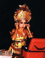 Oleg Tamulilingan dancer of Sadha Budaya group prepares to perform for tourists in Ubud