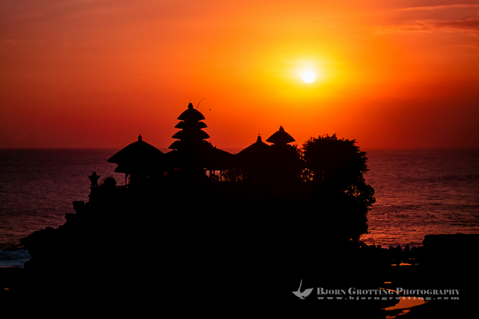 Indonesia, Bali, Tabanan, Tanah Lot. The Tanah Lot rock is the home of a pilgrimage temple, the Pura Tanah Lot. The sunsets here are famous.
