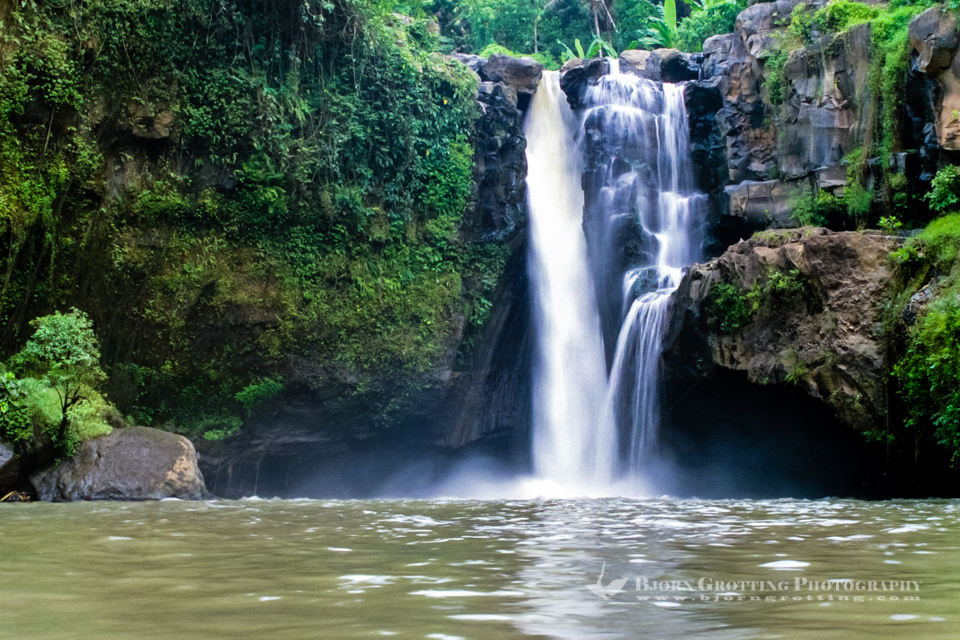 Indonesia, Bali, Gianyar, Tegenungan Waterfall. You can swim in the pool in front of the waterfall, the water is said to have magical powers...