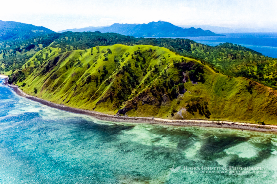 Indonesia, Maluku, South East Maluku, Pulau Liran. Liran is located just north of East Timor. The larger Wetar island in the background, looking east (from helicopter).