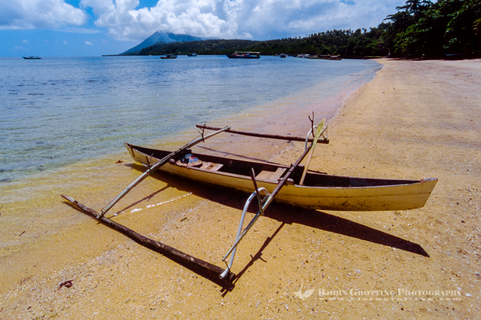 Indonesia, Sulawesi, Bunaken. Outrigger canoe on Liang Beach.