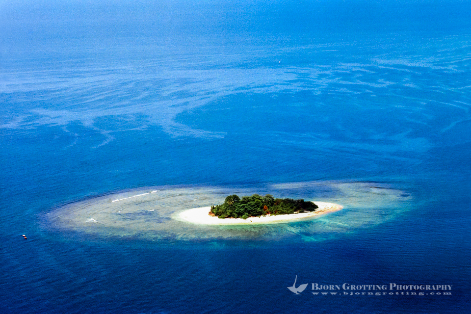 Indonesia, West Sumatra, Padang. Coral reef and a small island west of Padang (from helicopter).
